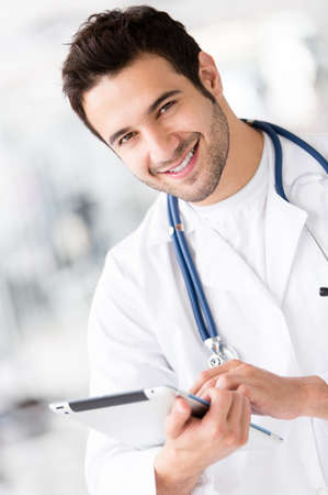 Gym doctor holding a tablet computer and smiling  photo