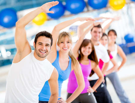 Group of people at the gym in an aerobics class photo