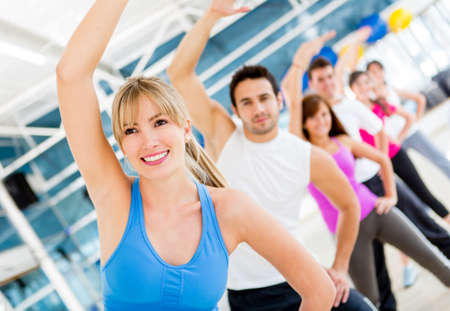 aerobic training: Group of gym people in aerobics class