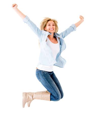donna entusiasta: Donna felice che salta con le braccia up - isolato su uno sfondo bianco
