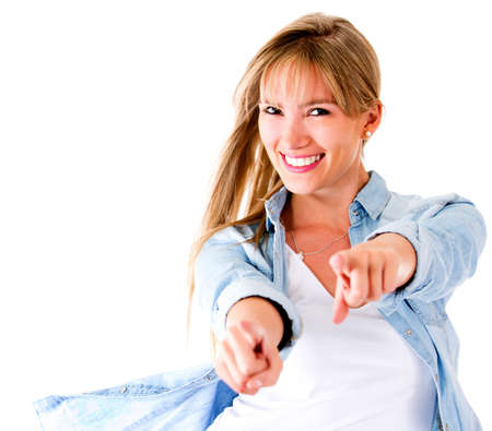 Woman having fun pointing to the camera - isolated over a white background  Stock Photo - 14710093