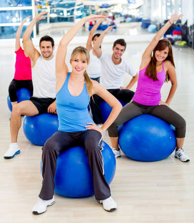 pilates man: Group of people at the gym stretching  Stock Photo