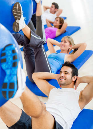 fitness instructor: Group of people at the gym in a Pilates class