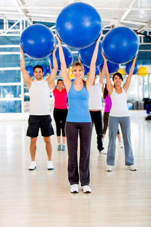 Group of people in a Pilates class holding a fitness ball photo