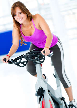 Beautiful woman at the gym doing spinning  photo