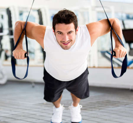 exercise: Strong handsome man exercising at the gym  Stock Photo