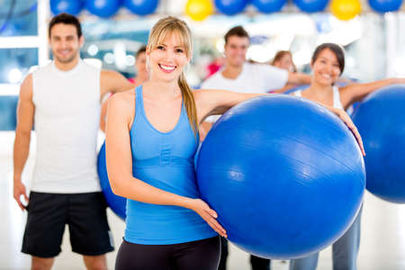 swiss ball: Group of people at the gym on a Pilates class