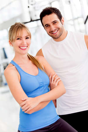 Couple of fit people at the gym looking happy  photo