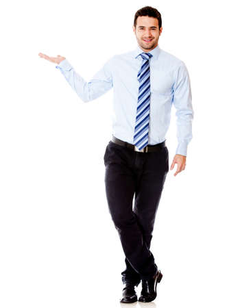 displaying: Businessman displaying something with his hand - isolated over a white background