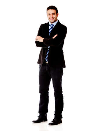 crossed arms: Fullbody business man smiling - isolated over a white background