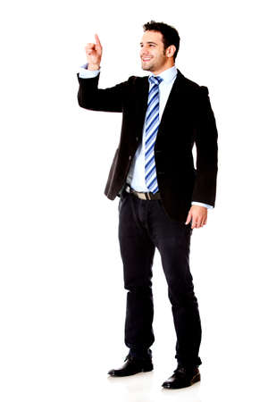 imaginary: Businessman touching an imaginary screen with his finger - isolated over white background