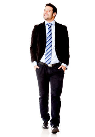 business people walking: Businessman walking - isolated over a white background