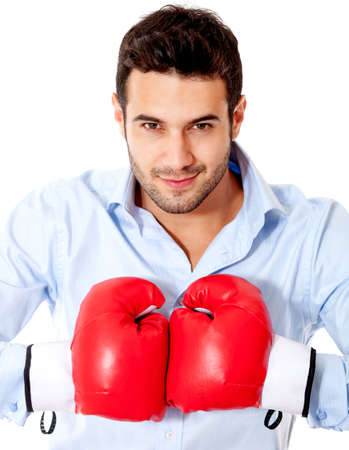 male boxer: Aggressive businessman with boxing gloves - isolated over a white background