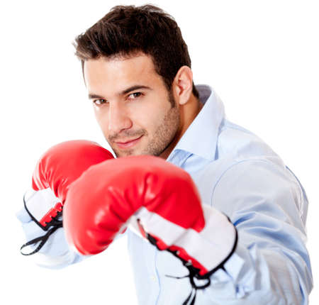 Business man ready to fight with boxing gloves - isolated over white background  photo