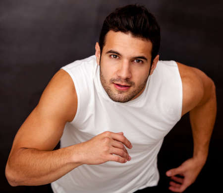 sportive: Sportive handsome male running - fitness concepts