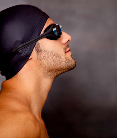 Profile of a professional male swimmer - sports concepts  photo
