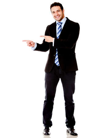 Business man pointing something - isolated over a white background  photo