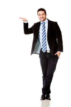 imaginary: Businessman with hand on something imaginary - isolated over white
