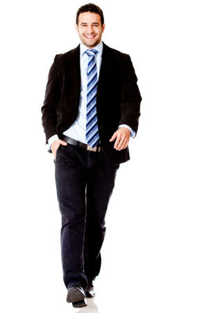 Handsome business man walking - isolated over a white background photo