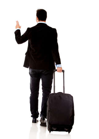 business traveler: Business man traveling with a bag - isolated over white background  Stock Photo