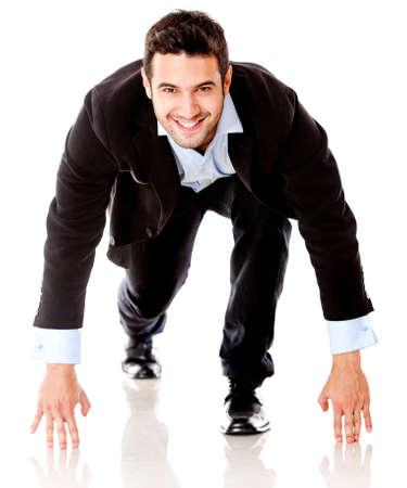 competitive business: Competitive business man ready to start running - isolated over white