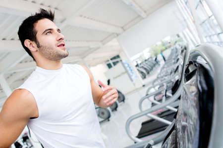 warm up exercise: Handsome gym man running on the treadmill  Stock Photo