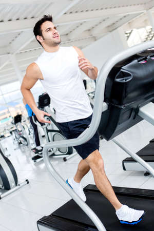 treadmill: Sportive gym man running on the treadmill