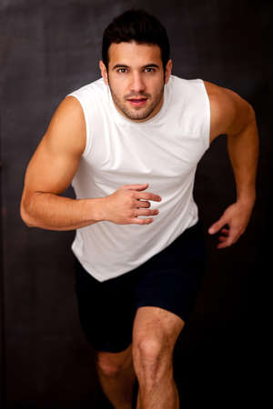 fit man: Sportive man running and looking very competitive  Stock Photo
