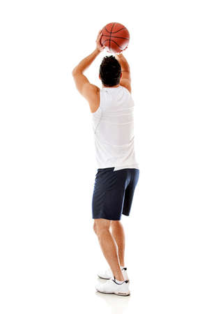 Man playing basketball - isolated over a white background  photo