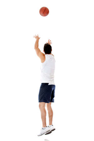 Basketball player throwing the ball - isolated over a white background  Stock Photo - 14781098