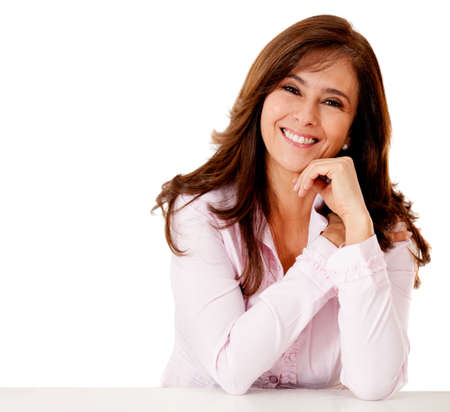 smiling: Friendly business woman smiling - isolated over a white backgorund