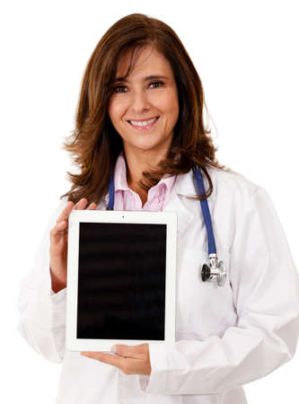 Doctor using a tablet computer - isolated over a white background photo