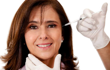 Woman getting a face lift with Botox - isolated over a white background  Stock Photo - 14857416