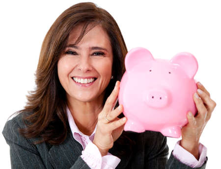 Happy businesswoman with her savings in a piggybank - isolated  photo