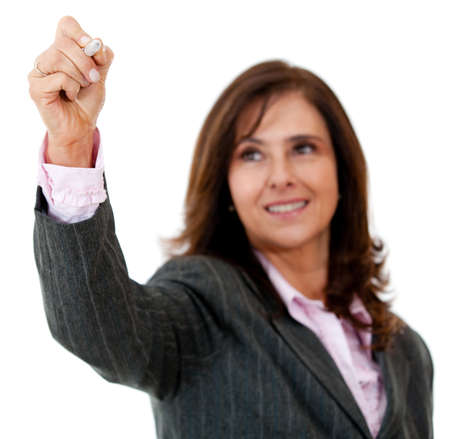 Business woman writing on an imaginary screen - isolated  photo