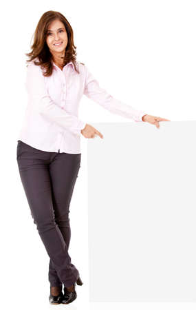 Businesswoman pointing at a banner - isolated over a white background  photo