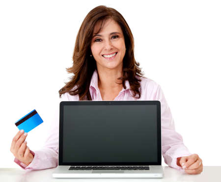 online payment: Woman online shopping with a credit card - isolated over white background  Stock Photo