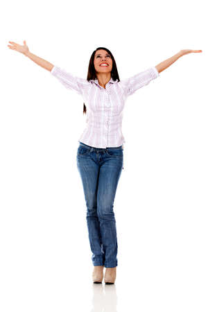 outstretch: Happy casual woman with arms up - isolated over a white background