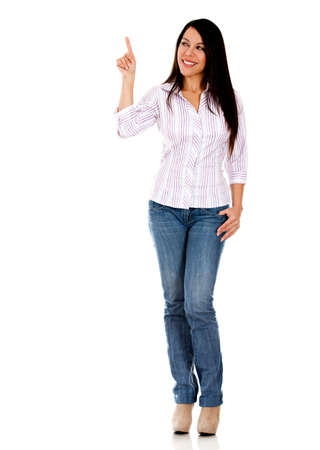 Woman pointing something with her finger - isolated over a white background  photo