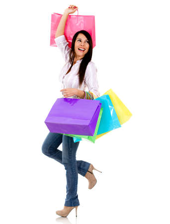 femme sac: Shopping woman Excited tenant des sacs - isol� sur un fond blanc Banque d'images