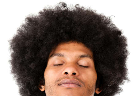 Afro man with eyes closed - isolated over a white background  photo