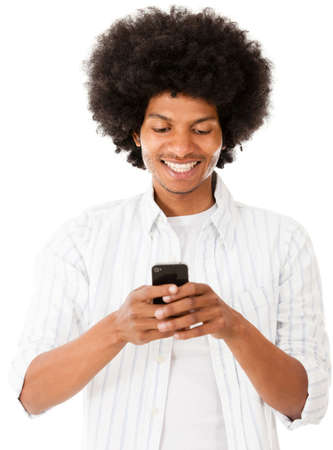 Black man texting on his phone - isolated over a white backgorund  photo
