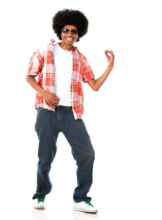 Happy black man listening to music - isolated over a white background  photo