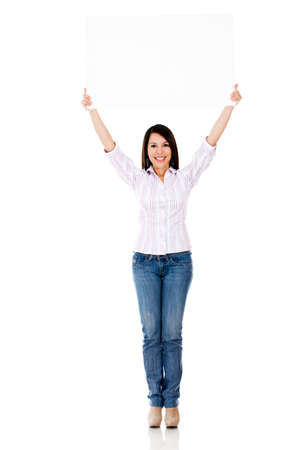 Woman holding up a banner - isolated over white background  photo
