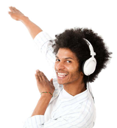 Cool black man listening to music - isolated over a white background  photo