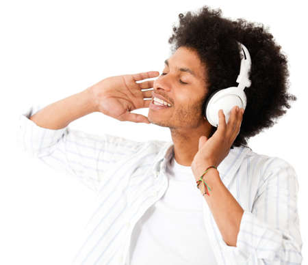 Black man with headphones - isolated over a white background  photo