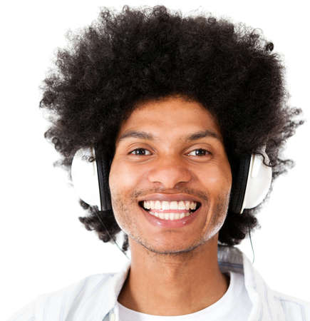 afro man: Afro man listening to music with headphones - isolated over white
