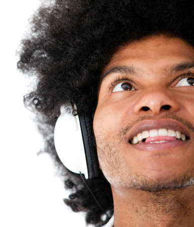 Afro man with headphones - isolated over a white background  photo