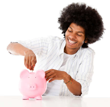 coinbank: Black man saving in a piggybank - isolated over a white background