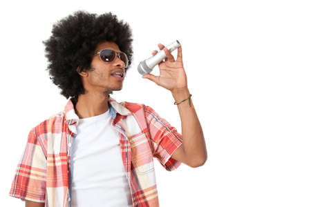 Afro singer holding a microphone - isolated over a white background  Stock Photo - 15036723